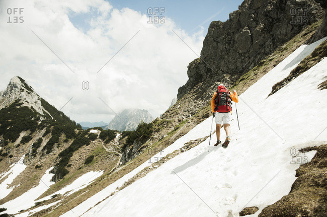 Backview of  a man hiking