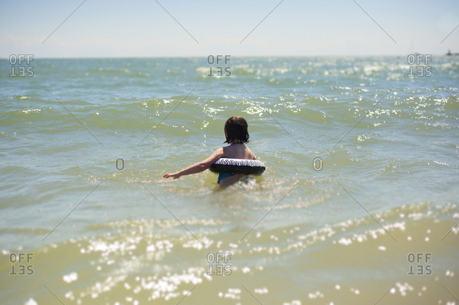 Girl Swimming in Waves, Cobourg Beach, Cobourg, Ontario, Canada
