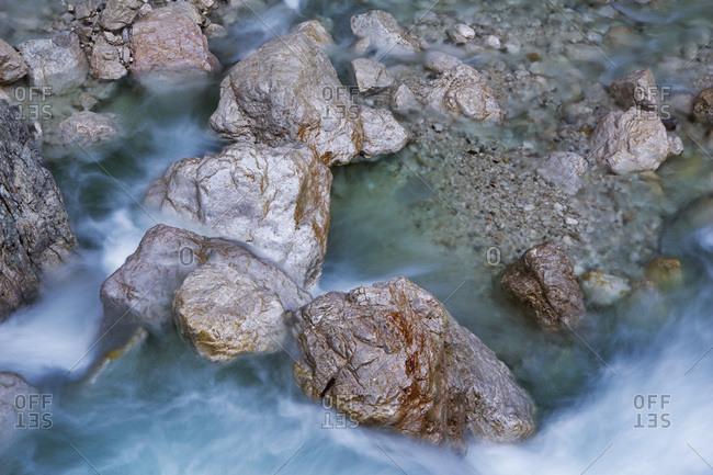 Long Exposure of Rocks and Soca River in Mlinarica Gorge, Julian Alps, Triglav National Park, Slovenia