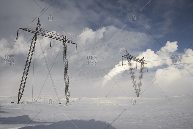 Power Lines in Winter Landscape with Steam from nearby Geothermal Power Plant in Background, Hellisheidi, Iceland