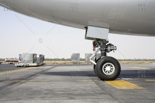 Close-up of Airplane Landing Gear on Tarmac, Dubai, United Arab Emirates