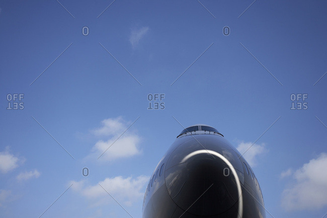 Low Angle View of Airplane Nose with Blue Sky, Surrey, England