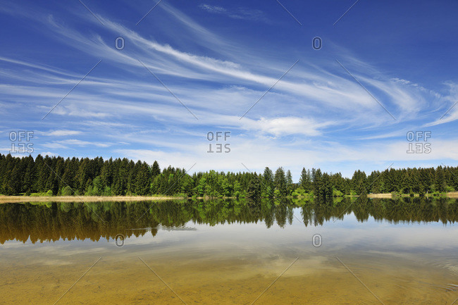 Landscape and Sky Reflected in Lake Hegratsried in Spring, Hegratsried, Halblech, Swabia, Bavaria