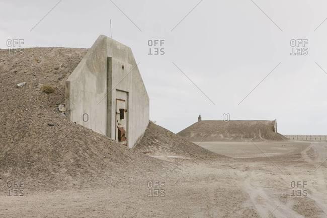Abandoned munitions bunkers in desert