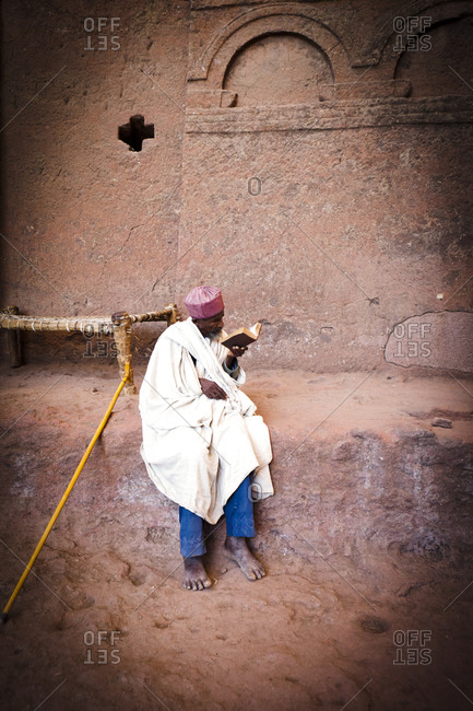 Local man reading bible in Lalibela