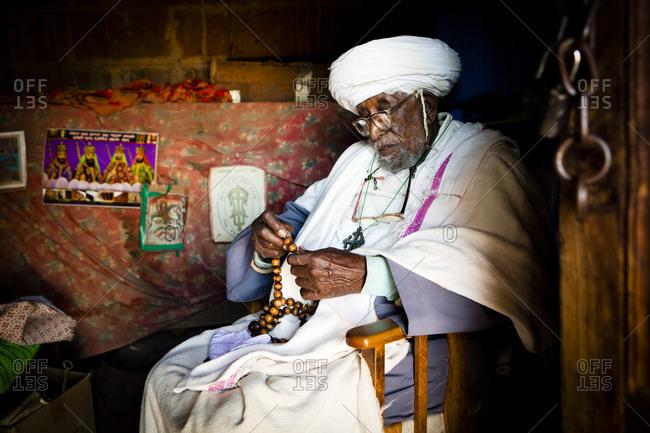 Ethiopian senior man praying