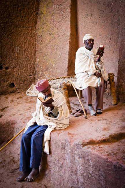 Two local men reading bible in Lalibela