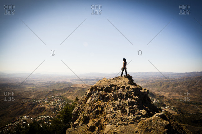 Woman standing on the top of hill in Ethiopia
