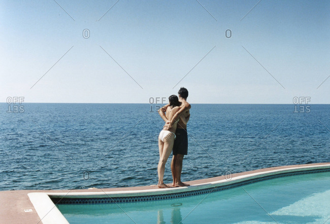 Couple By Pooling Looking at the Ocean