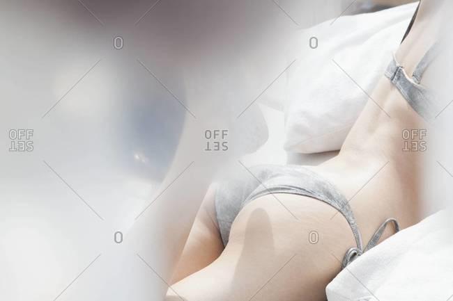 Woman in Lying in Bed in Her Underwear