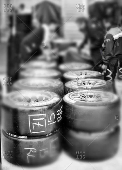 Race car paddock with stacks of tires at Le Mans