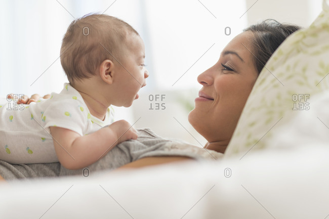 Mother playing with baby boy (2-5 months)