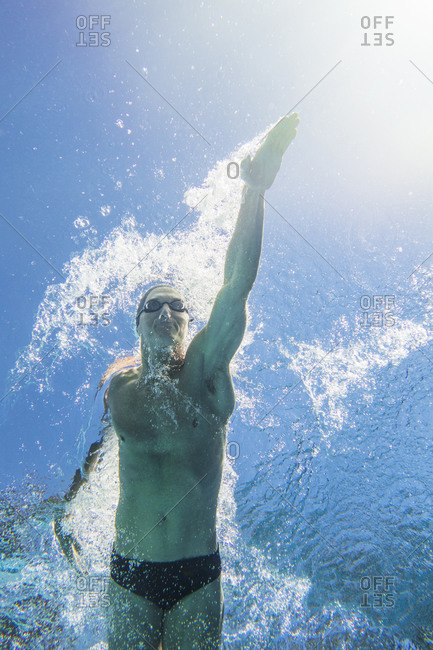Underwater view of athletic swimmer
