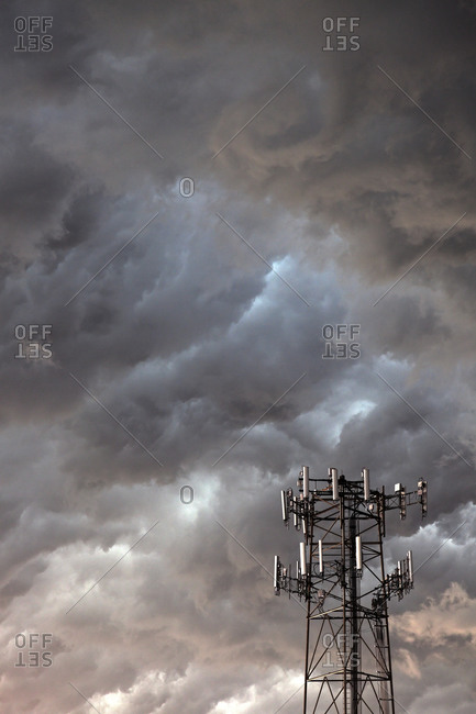 Telecommunication antenna in front of storm clouds