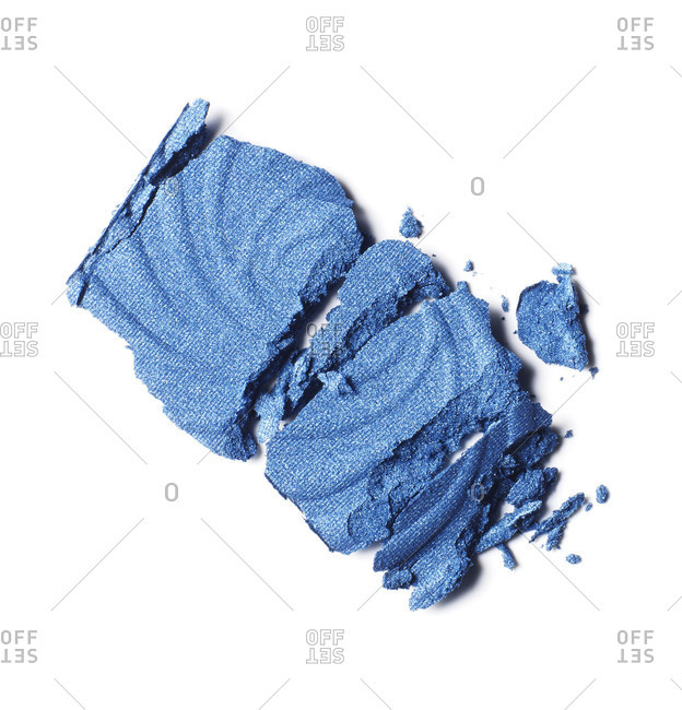 Blue make up smudged on white background