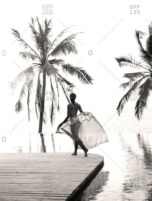 Woman with sarong by an infinity pool