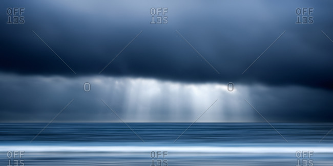 Sunlight in overcast sky over the sea