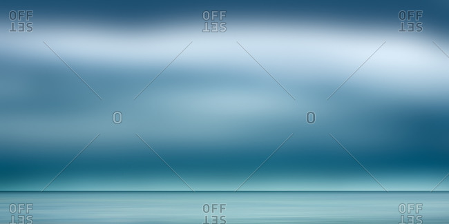 Blurred seascape and blue sky