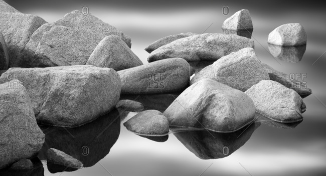 Rocks in water on seashore