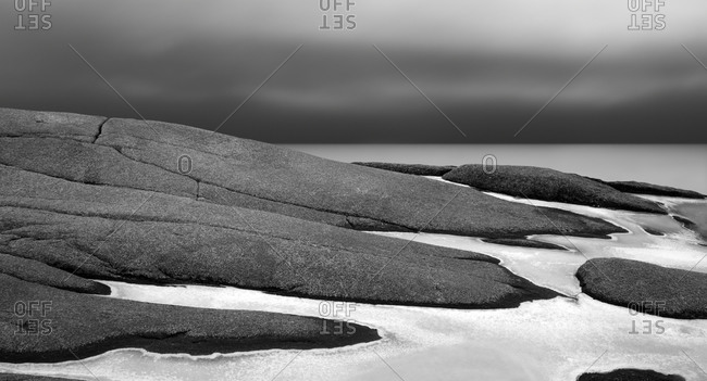 Rocky seashore covered with ice