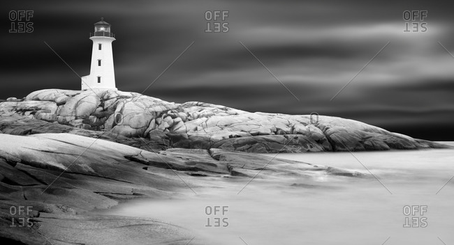 Lighthouse on rocky seashore