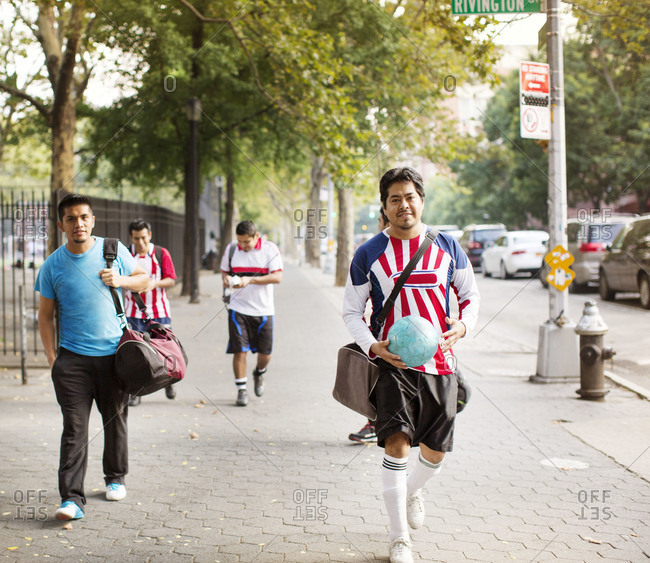 Soccer team walking on street