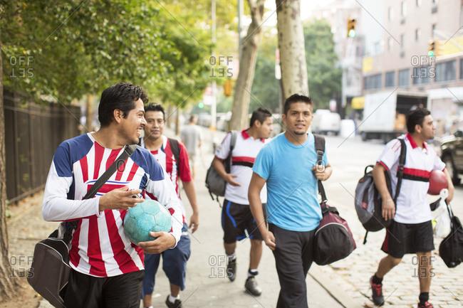 Soccer team walking on street