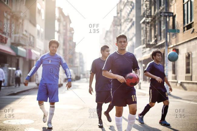 Soccer team walking in sunlit street