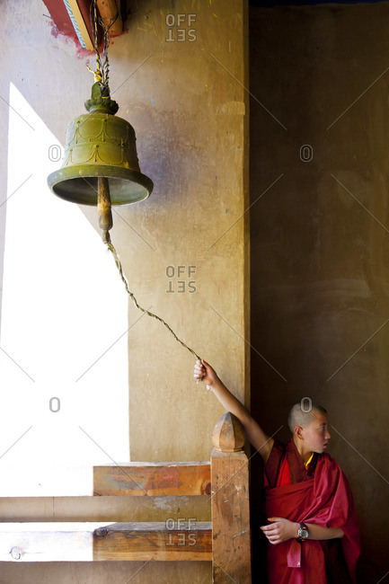 Young monk ringing bell at the Tsechu Festival in Gangtey Monastery, Phobjikha Valley, Bhutan, October 10, 2011