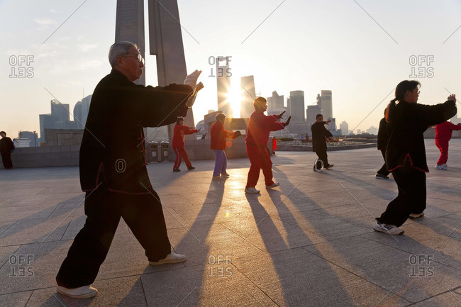 People exercising Tai Chi in the early morning at The Bund, Shanghai, China, January 17, 2012