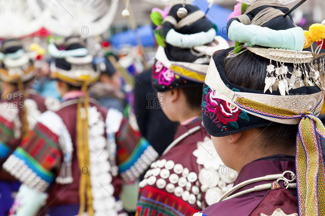 Black Miao girls dancing at festival, Kaili, Guizhou Province, China