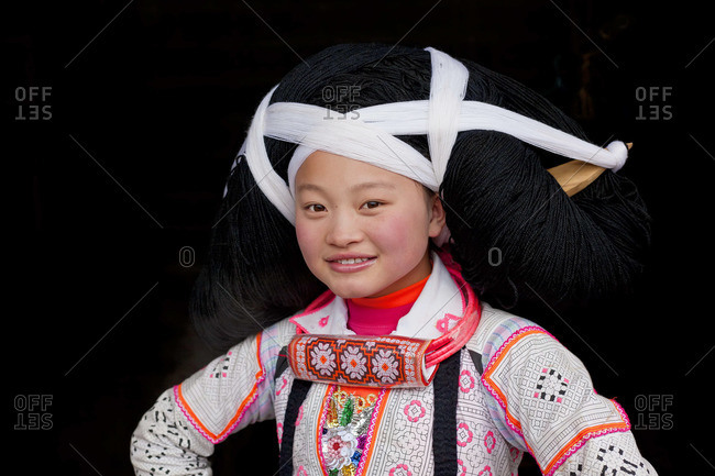 Portrait of a Long Horn Miao girl, Sugao, Guizhou Province, China, January 31, 2012