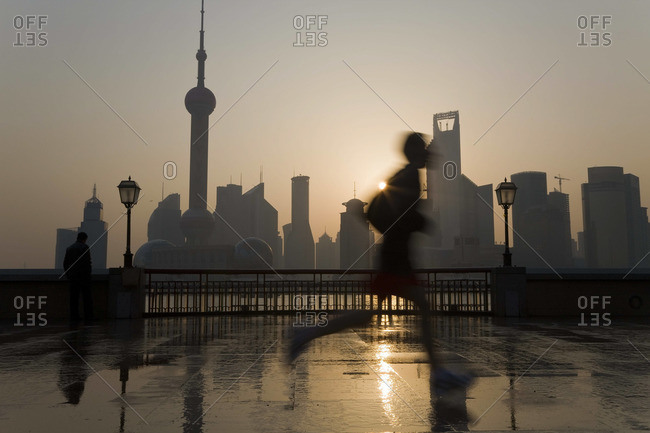 Runner on The Bund, with Pudong skyline in the background, Shanghai, China
