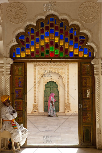 View through doorway of woman sweeping, Meherangarh Fort, Jodhpur, Rajasthan, India, March 14, 2010