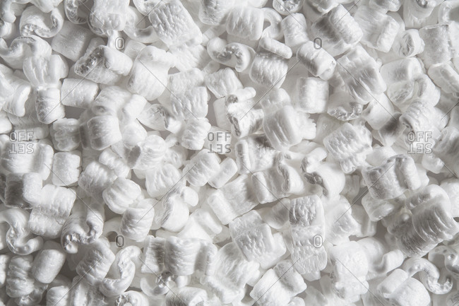 Heap of packaging shapes, white polystyrene material