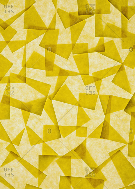 Post it notes arranged and overlapping, above a light source.