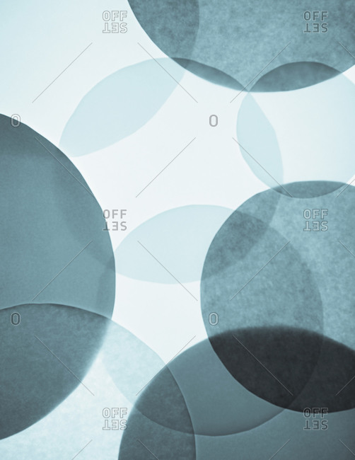 Overlapping circular shapes in various shades of blue.