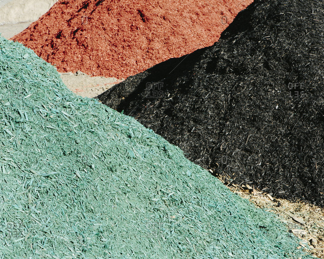 Piles of multi-colored bark wood chips used for landscaping