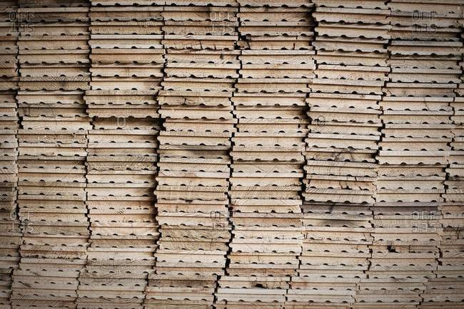 Stacks of reclaimed, cleaned up planks of wood for re-use
