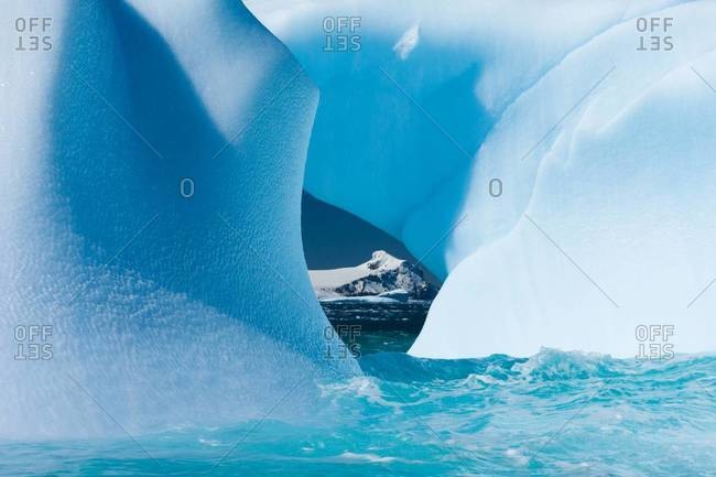Floating icebergs framing a view of the ocean