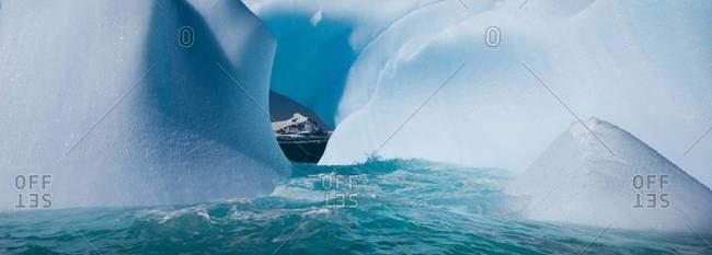 Floating icebergs framing another iceberg