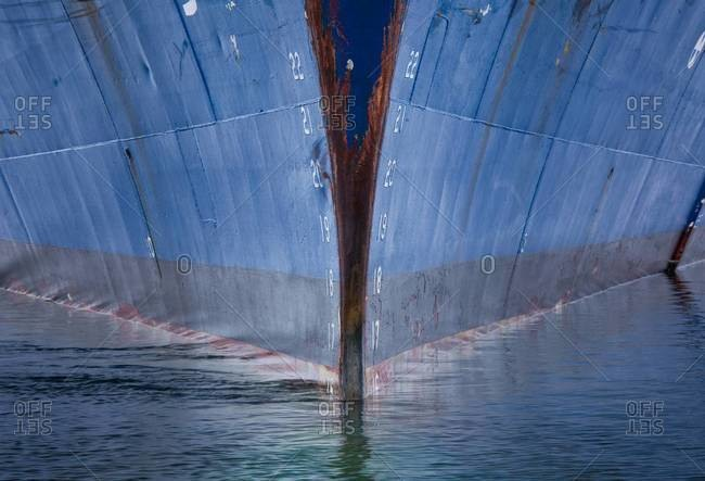 The prow of a ship in water