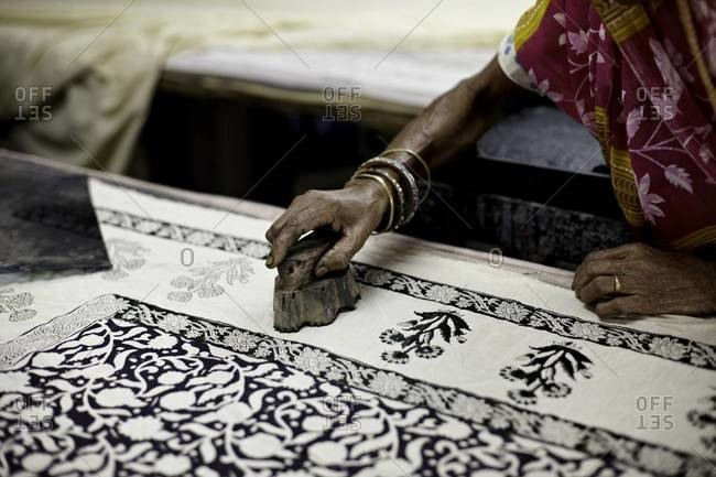 Indian woman hand block prints on textile