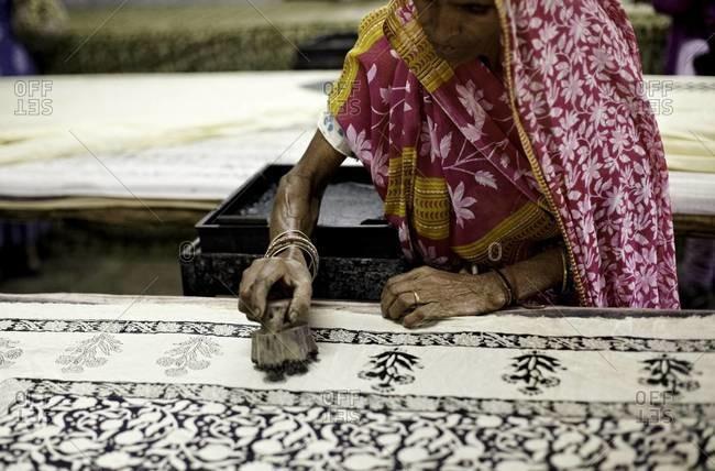 Indian woman at block printing table