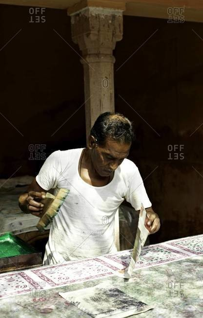 Indian man hand block prints on textile