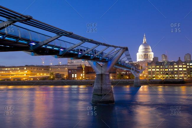 River Thames, Millennium Bridge and St. Paul's Cathedral at dusk, London, England, United Kingdom