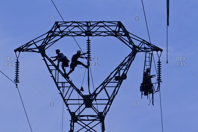 Workers on a pylon