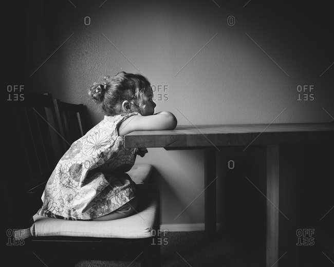 Little girl waiting at the table