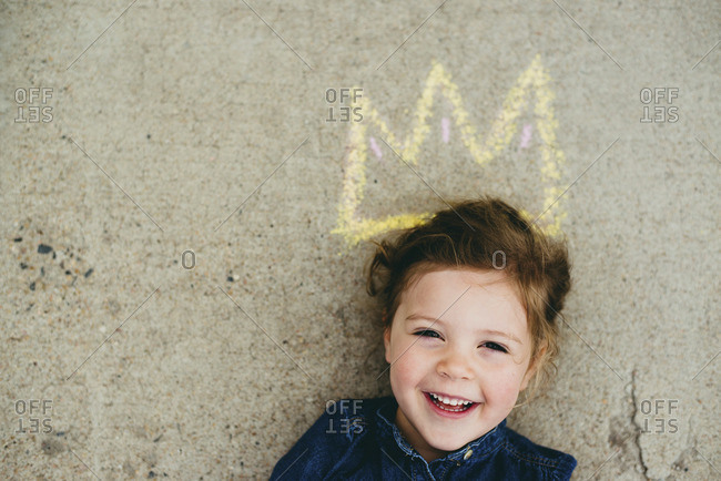 Overhead view of smiling girl with crown