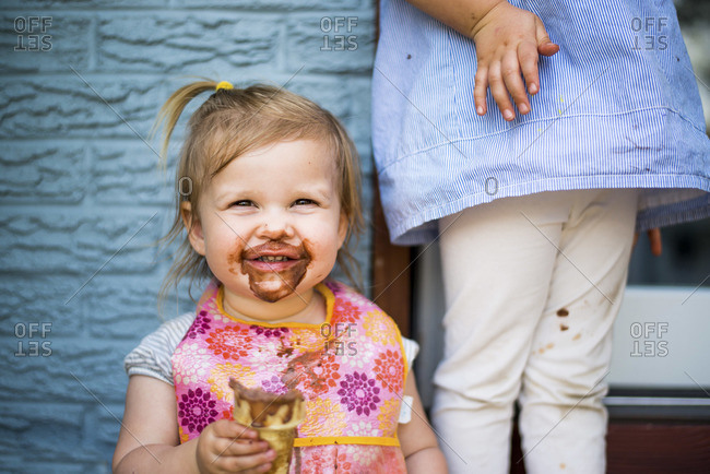 Cute girl eating chocolate ice cream